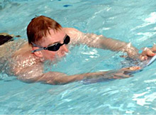 Man swimming using float